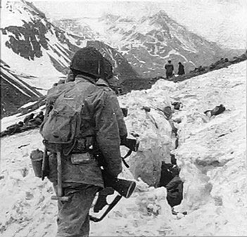 US troops traveling across snow and ice during the Battle of Attu in the Aleutian Islands, May 1943 (Australian War Memorial)