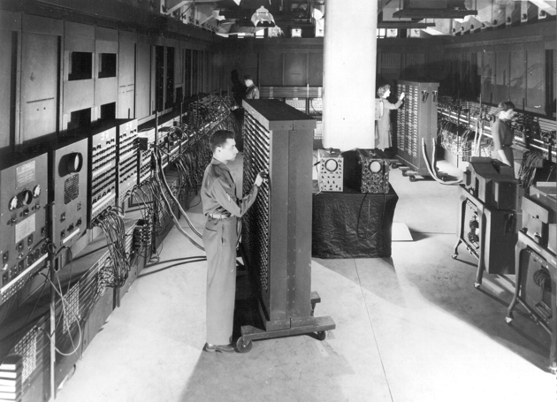 Cpl. Irwin Goldstein sets switches on one of the ENIAC's function tables at the Moore School of Electrical Engineering, University of Pennsylvania, 1946 (US Army photo)