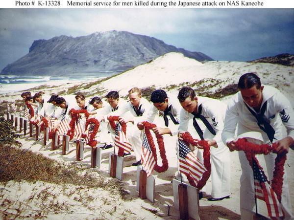 US Navy sailors honoring fellow sailors killed during the Pearl Harbor attack, Naval Air Station Kaneohe, Oahu, 30 May 1942 (US National Archives)