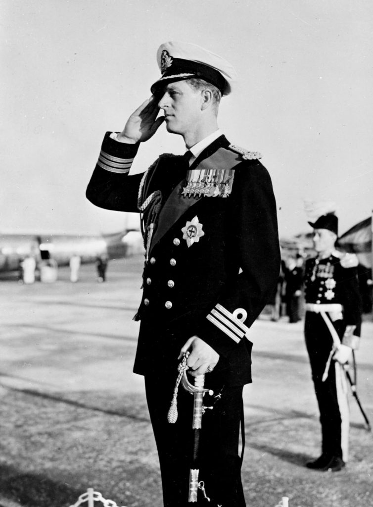 Prince Philip, Duke of Edinburgh in the uniform of a Commander, Royal Navy, takes a Royal Salute during his visit to Malta in 1952 (Imperial War Museum: A 32405)