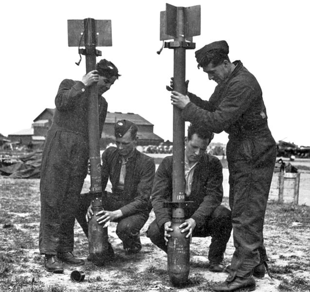 Attaching warheads to RP-3 3-inch Rocket Projectiles (Men attaching 60-lb warheads to 3-inch RP-3 Rocket Projectile bodies, WWII (Imperial War Museum)