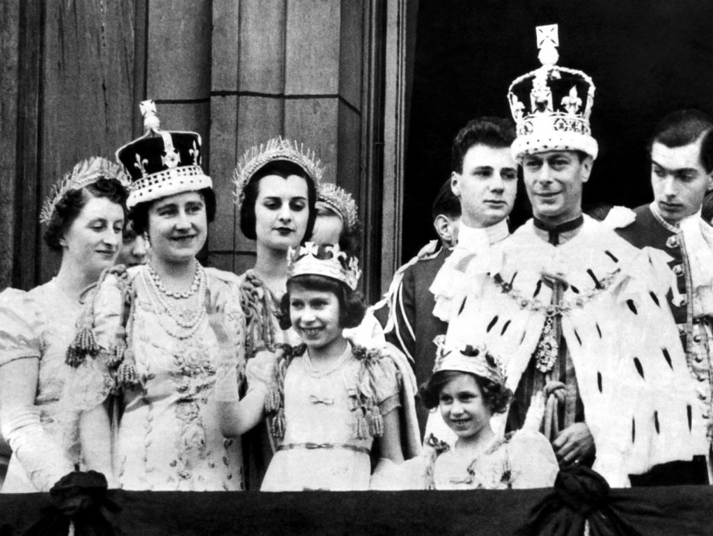 King George VI, Queen Elizabeth, and Princesses Elizabeth and Margaret at Buckingham Palace on the king's coronation day, London, 12 May 1937 (United Kingdom National Archives)