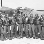 "Men of the US 99th Fighter Squadron (""Tuskegee Airmen"") and a P-40 fighter in North Africa, 1943 (US Air Force photo)"