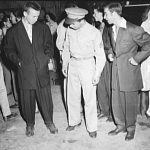 Soldier inspecting zoot suits at the Uline Arena, Washington DC, 1942 (Library of Congress)