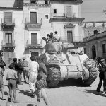 Sherman tank of XIII Corps, British Eighth Army in Francofonte, Sicily, 13-14 Jul 1943 (Imperial War Museum: 4700-39 NA 4448)
