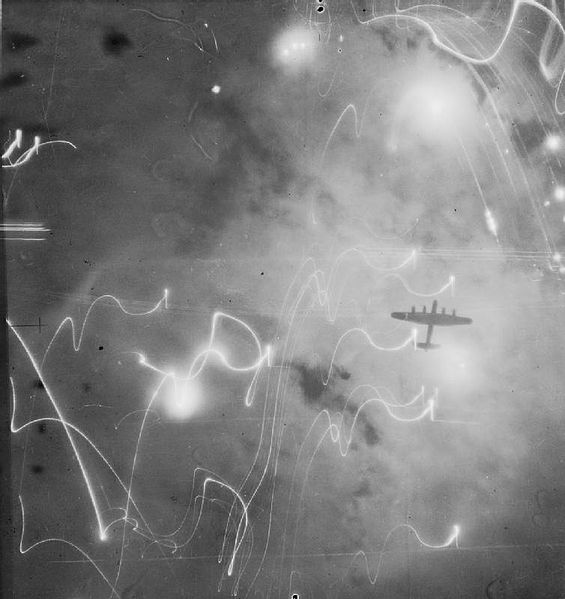 RAF Lancaster bomber over Hamburg, Germany, January 30/31, 1943 (Imperial War Museum: C-3371)