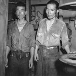 Survivors from Japanese light cruiser Jintsu, dressed in US Navy uniforms, aboard destroyer USS Nicholas, 13 Jul 1943 (US National Archives)