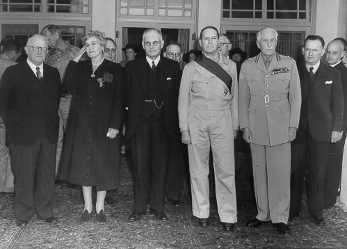 US Ambassador Nelson Johnson, Lady Gowrie, Australian Prime Minister John Curtin, Gen. Douglas MacArthur, Governor General Lord Gowrie, and Frank Forde, Australia, 8 Jun 1943 (public domain via WW2 Database)