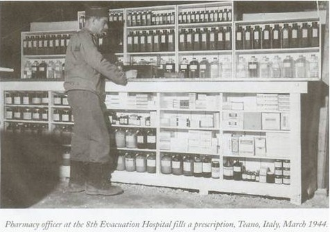 Pharmacist at the US 8th Evacuation Hospital, Teano, Italy, March 1944 (US National Archives)