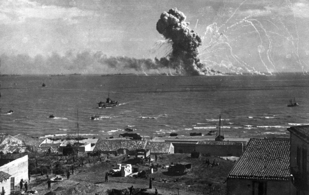 American transport SS Robert Rowan exploding after being hit by German Ju 88 bombers, Gela, Sicily, 11 July 1943—all 421 aboard survive (US Army Signal Corps photo)
