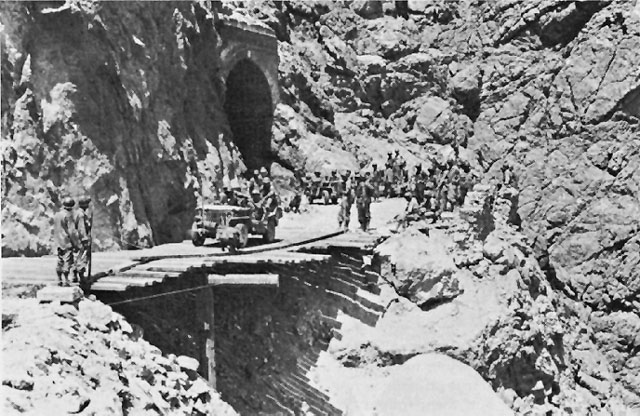 "The ""Bridge in the Sky"" hung by US Army 10th Engineer Battalion, Cape Calava, Sicily, 13 Aug 1943 (US Army Center of Military History)"