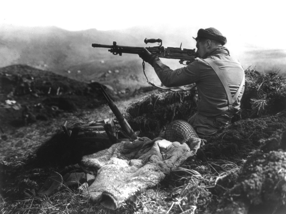 Canadian soldier inspecting a captured Japanese machine gun, Kiska, Aleutian Islands, 16 Aug 1943 (Source: US Library of Congress)