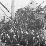 US troops en route to landing beaches at Salerno, Italy cheer the Italian surrender, 8 September 1943 (US Center for Military History)