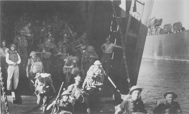 Australian troops debarking from LST landing ships for the occupation of Lae, New Guinea, September 1943 (US Army Center of Military History)