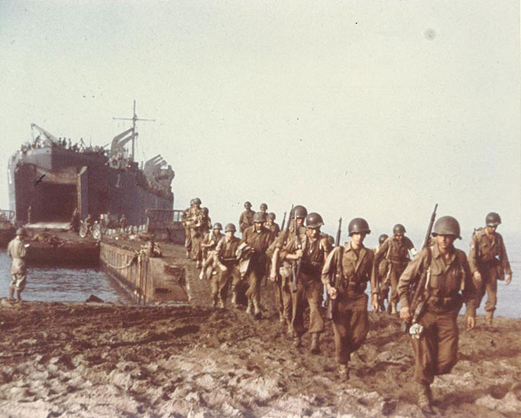 USS LST-1 landing US troops on a beach near Salerno, Italy, September 1943 (US National Archives)
