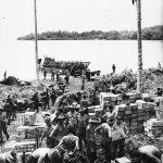 Australian transport company unloads supplies at Finschhafen, Oct. 1943 (Australian War Mermorial)