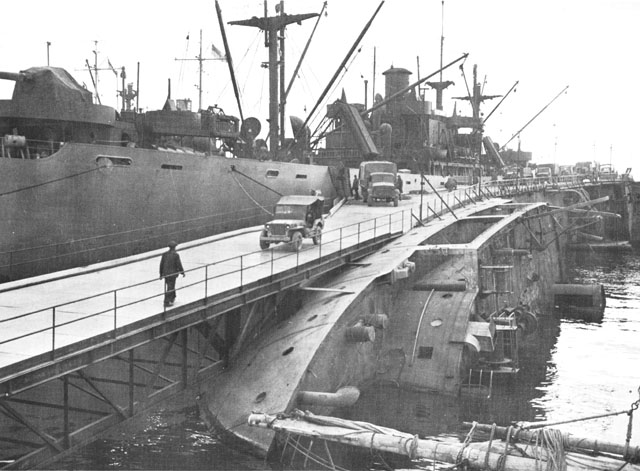 Pier built by US Army engineers over hull of sunken ship, Naples, 1943 (US Army Center for Military History)