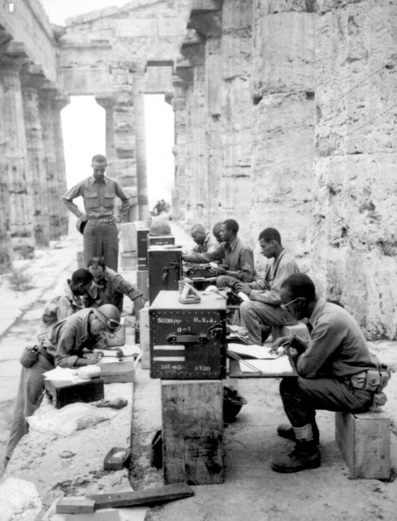 US soldiers in makeshift Fifth Army office in ancient Temple of Neptune in Paestum, Italy, 22 September 1943 (US National Archives)