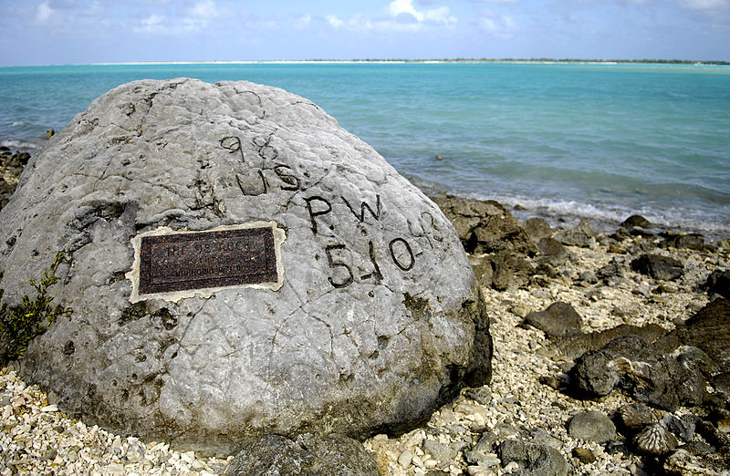 "Memorial for the 98 US civilian contract POWs who were executed by the Japanese on 7 Oct 1943; an unidentified prisoner escaped and chiseled ""98 US PW 5-10-43"" on this rock before he was executed himself (US Air Force photo)"