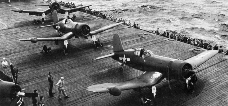 F4U-2 night-fighter Corsairs equipped with air intercept radar aboard carrier USS Intrepid in the Marshall Islands, 1944—see radome in right outer wing (US Navy photo)