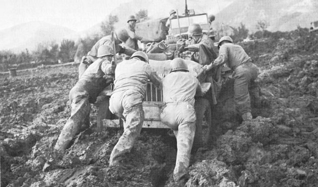 Soldiers of US Fifth Army battle mud in Italy, fall 1943 (US Army Center of Military History)