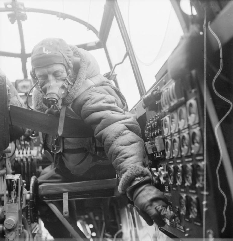 Flying Officer J.B. Burnside, Lancaster flight engineer of No.619 Squadron RAF checks settings on the control panel (Imperial War Museum: CH 12289)
