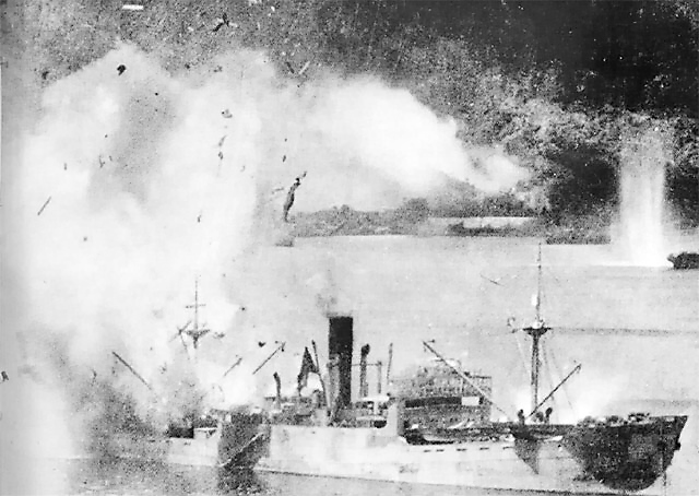 Japanese freighter exploding after being hit by a bomb, Rabaul (public domain via WW2 Database)
