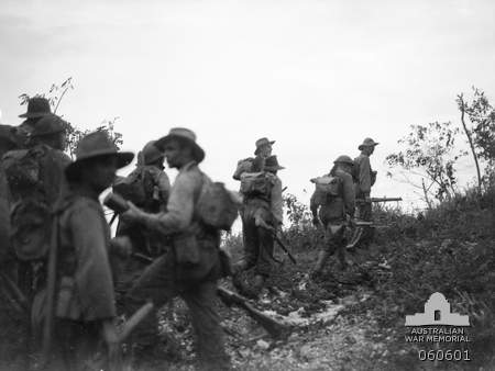 Australian soldiers from the 2/48th Battalion around Sattelberg, New Guinea, 17 November 1943 (Australian War Memorial #060601)