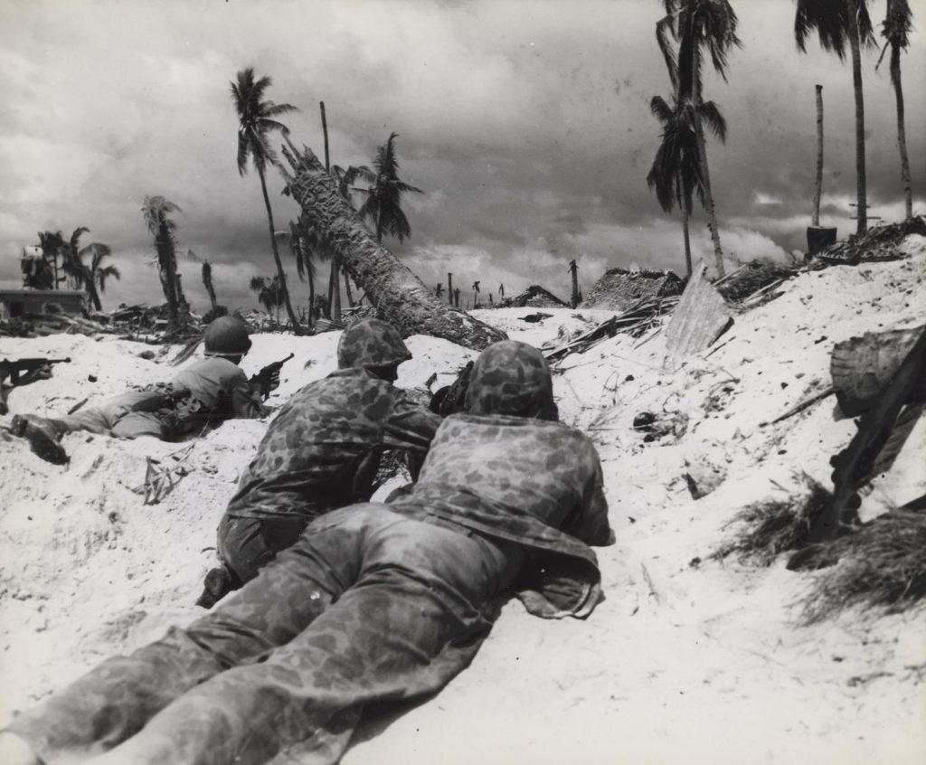 US Marines on landing beach at Tarawa, Gilbert Islands, 20 Nov 1943 (US Marine Corps photo)