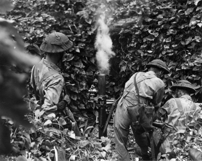 New Zealand soldiers training with a 3-inch mortar on Mono, Treasury Islands, 1943 (National Library of New Zealand)