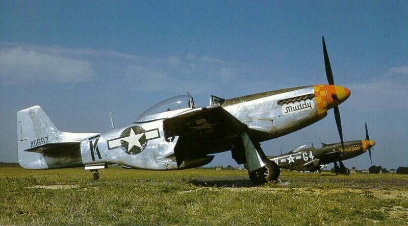 P-51D Mustangs of the US 357th Fighter Group, Leiston, England, 1944-45; P-51 in foreground in natural finish, P-51 in background in camouflage paint (US National Archives)