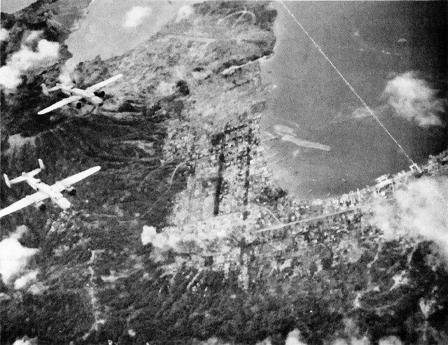US COMAIRSOLS B-25 Mitchell bombers attacking Rabaul, New Britain, late 1943; note Lakunai airfield in top center of photo (public domain via WW2 Database)
