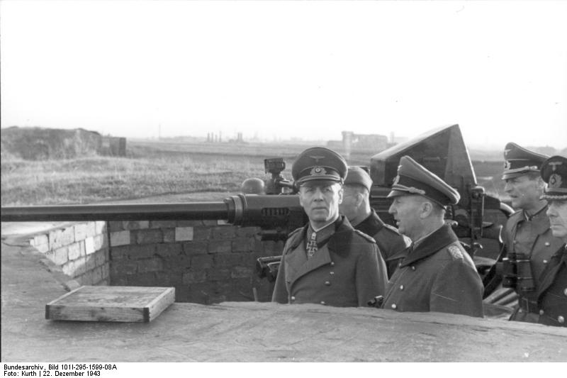 Field Marshal Rommel and Luftwaffe Lt. Gen. Rupprecht inspecting artillery position, Dunkirk, France, 22 Dec 1943 (German Federal Archive: Bild 101I-295-1599-08A)