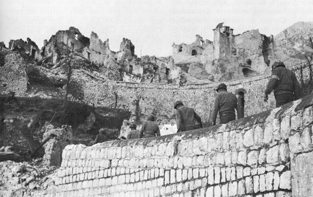 US Army medics entering San Pietro, Italy, Dec 1943 (US Army Center for Military History)