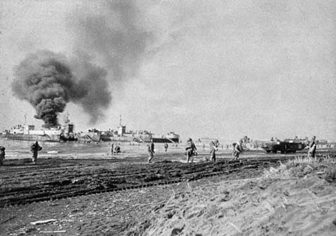 US Army troops land at Anzio, Italy, while ships are bombed by the Luftwaffe, January 1944 (US Army photo)
