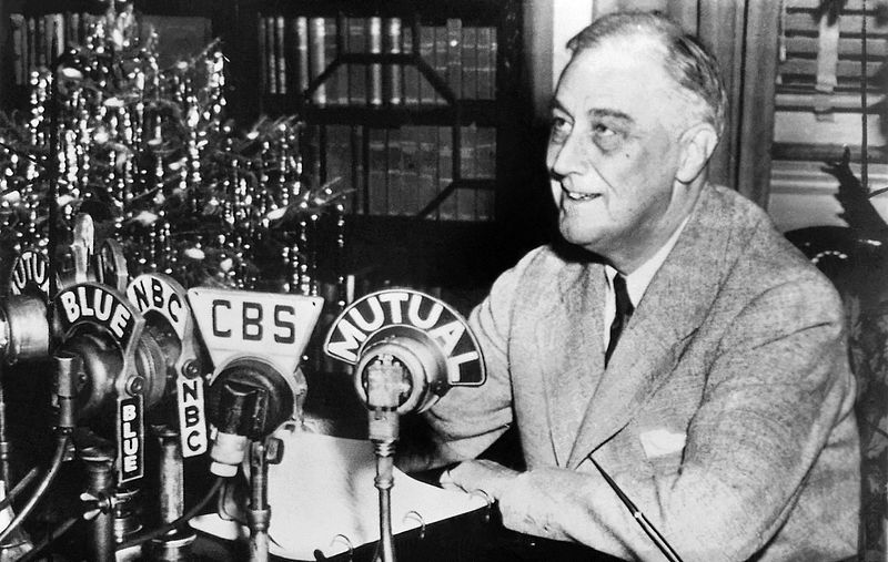 Pres. Franklin Roosevelt at his home in Hyde Park, NY, delivering a Fireside Chat, 24 Dec 1943 (US National Archives)