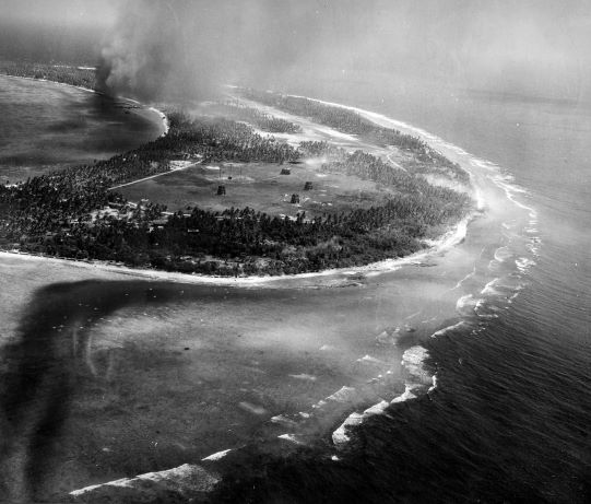 Strike photo of Kwajalein, Marshall Islands taken by aircraft from USS Enterprise, 30 Jan 1944 (US National Museum of Naval Aviation)