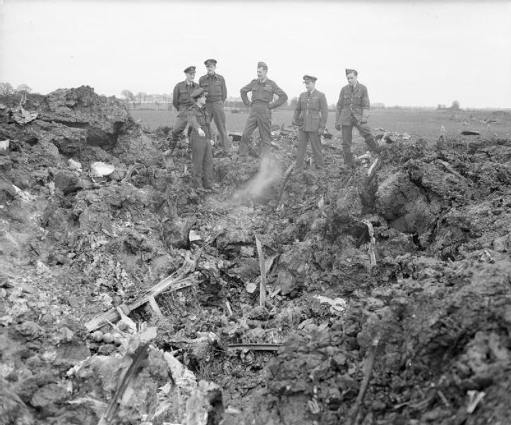 Air Marshal Sir Roderick Hill is shown the wreckage of a German Junkers Ju 188 bomber shot down by the RAF over Essex on the night of 21 March 1944 (Imperial War Museum CH 12537)