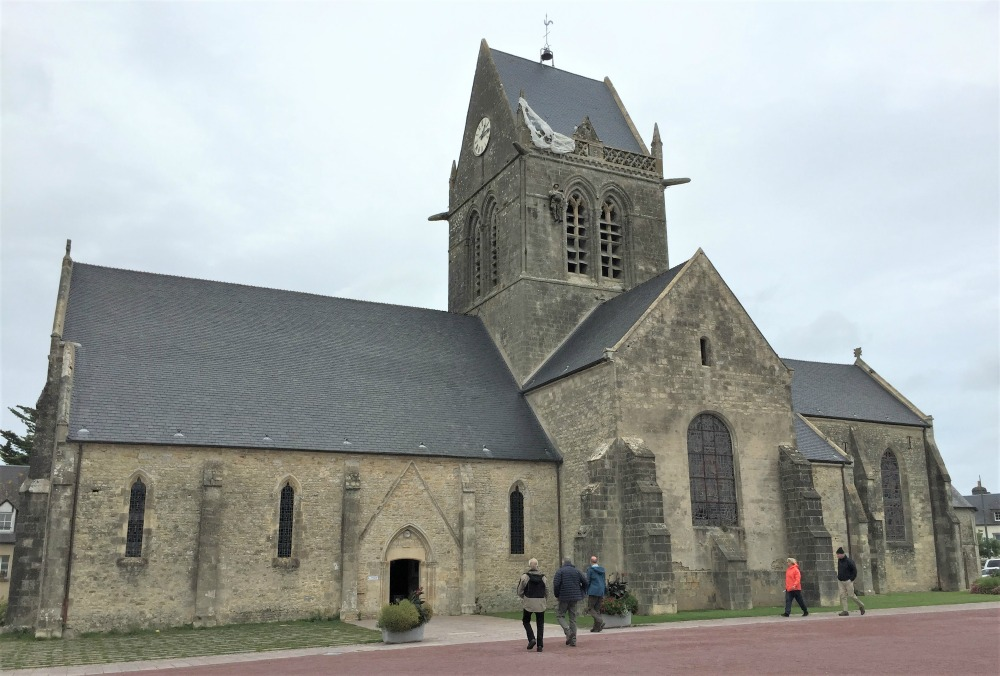 Church of Sainte-Mère-Église, France, where US paratroopers landed on D-day. (Photo: September 2017, Sarah Sundin)