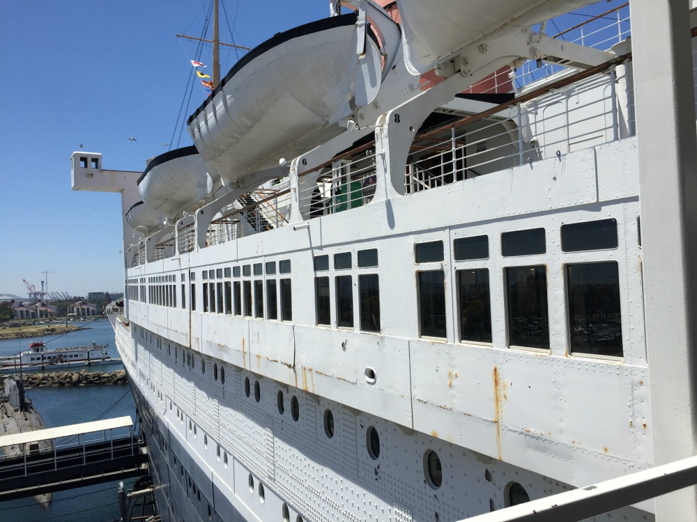 Boarding the Queen Mary - the sun deck (under the lifeboats), the promenade deck (rectangular windows), and main deck (round portholes).