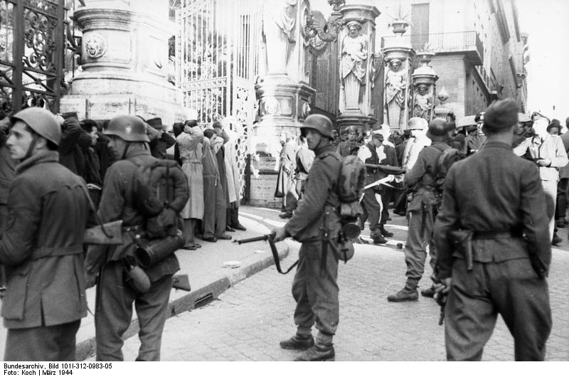 German troops and Italian collaborators round up civilians in front of the Palazzo Barberini, Rome, 23 March 1944, before the Ardeatine Caves Massacre (German Federal Archive: Bild 101I-312-0983-05)