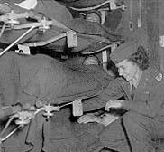 Flight nurse based in Prestwick, Scotland, preparing patients for transatlantic flight, 1944 (USAF photo)