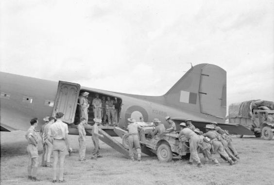 Troops of 5th Indian Division loading a jeep into a Douglas Dakota of No.194 Squadron RAF during the reinforcement of the Imphal Garrison in India, March 1944. (Imperial War Museum)