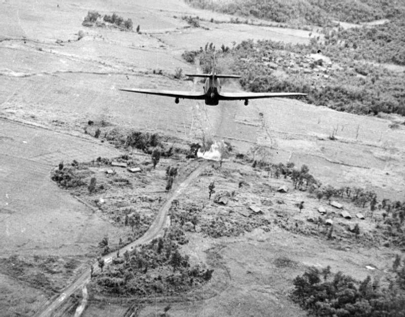 "Hawker Hurricane of RAF No.42 Squadron piloted by Flying Officer ""Chowringhee"" Campbell, attacking a bridge in Burma on the Tiddim Road near Imphal (Imperial War Museum: CF 175)"