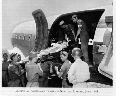 Patient being loaded into plane for air evacuation, Nettuno, Italy, June 1944 (US Army Office of Medical History)