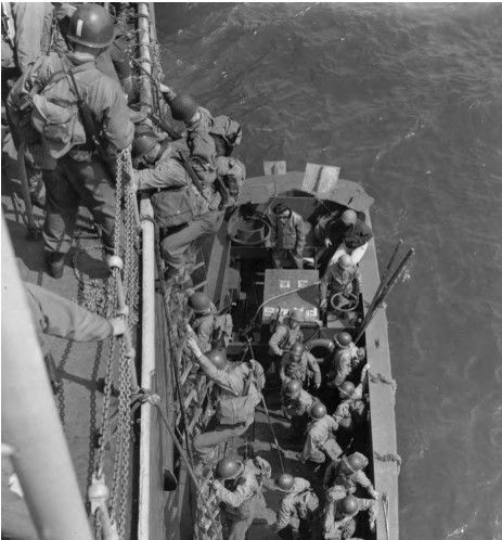 Exercise Fabius, Slapton Sands, England, May 1944. US infantry descend into an LCVP during D-day invasion practice. (US Army Center of Military History)