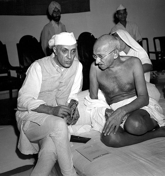 "Pandit Nehru and Mahatma Gandhi at All-India Congress Committee, August 8, 1942, when the ""Quit India"" resolution was adopted, calling for the immediate dissolution of British rule. (Public domain via Wikipedia)"