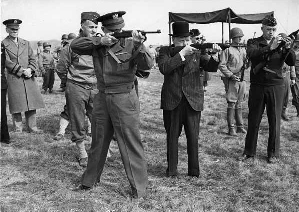 Maj. Gen. Edward Brooks (behind Eisenhower) demonstrating M1 Carbines to Gen. Dwight Eisenhower, Prime Minister Winston Churchill, and Gen. Omar Bradley, England, 15 May 1944 (US National Archives)