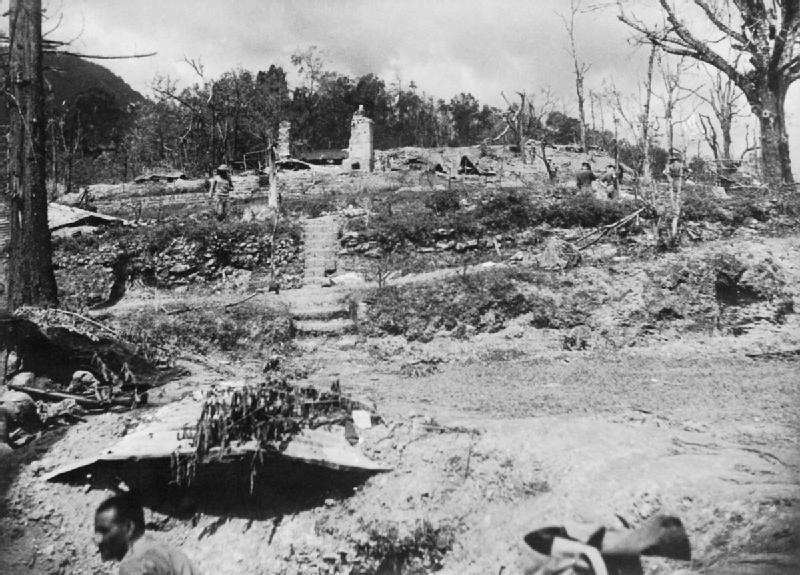 Destroyed commissioner's bungalow and tennis court, Kohima, India, Mar-Jul 1944 (Imperial War Museum)