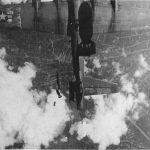 """B-17G Flying Fortress """"Miss Donna Mae II"""" drifting under another bomber over Berlin, 19 May 1944 (US National Archives)"""